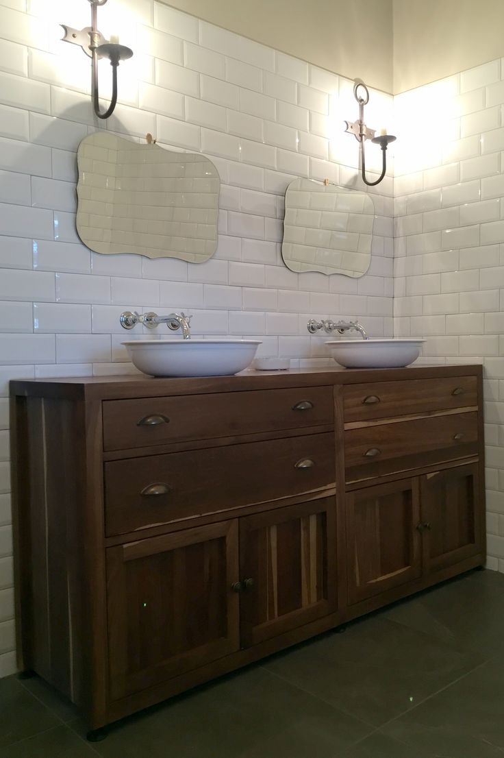 A custom kiaat double vanity unit. A similar unit in oak was made for a second bathroom.