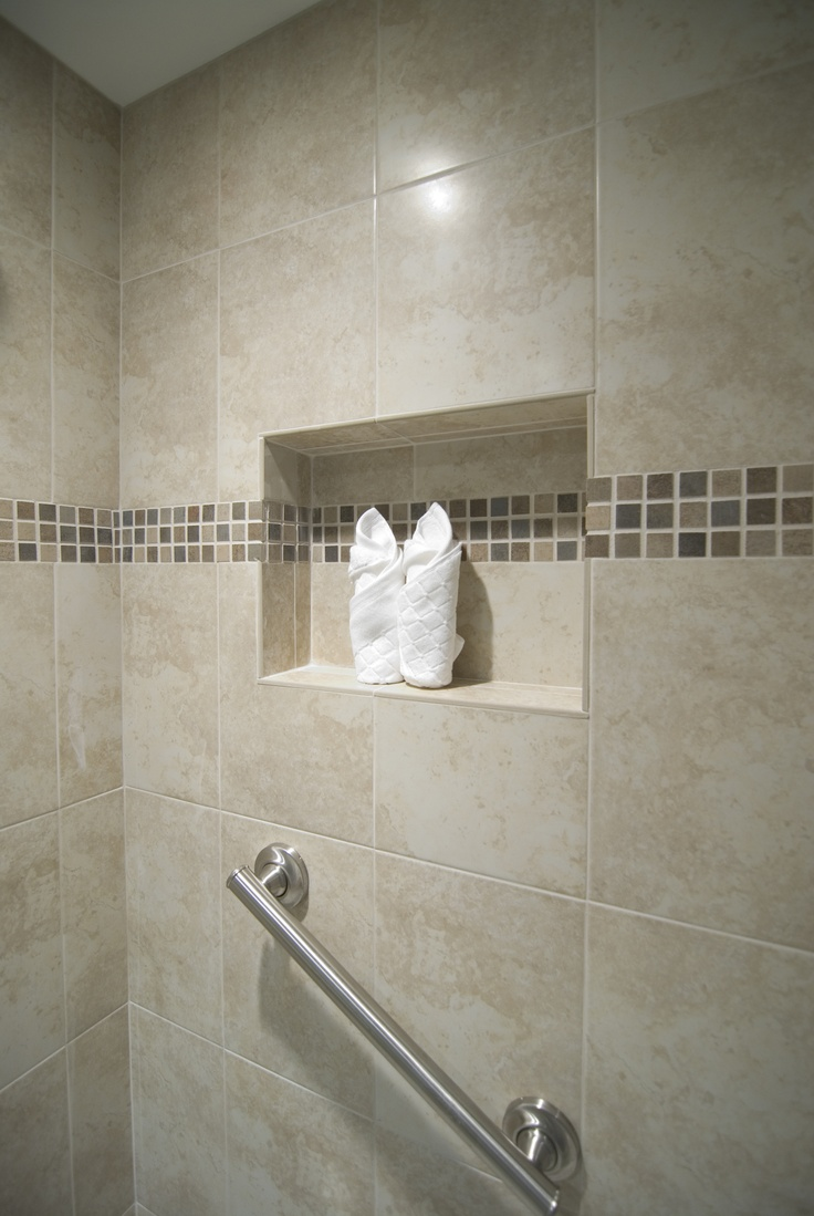 The shower recessed area  and walls are accented with 1x1 Oliva Oceano Mosaic.  #bathroom  #shower