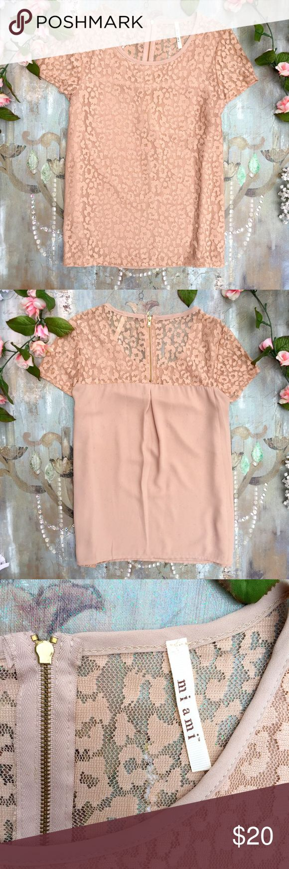 Blouse This peach, cream, tan blouse will fit sizes Small and Medium perfectly!🎀 The Blouse on the front has a lace cheetah print and it is lined so it is not see through!💕 The back falls down so elegantly and there is a zipper at the top for easy removing and dressing!😊 This top has Never been worn and is in Perfect Condition!💐 NWOT!🌸 Miami Tops Blouses