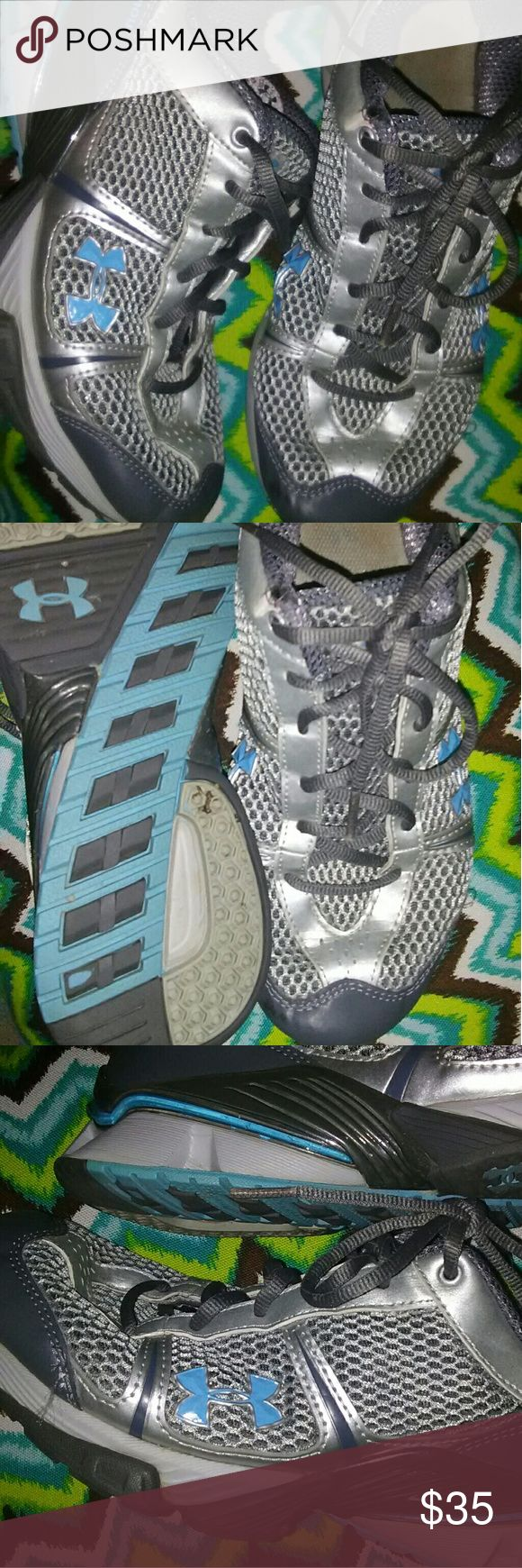Under Armour Running Shoes Good used Condition Can fit a womens 7.5 Very comfortable Turquoise, silver, and charcoal gray in color One small spot on the toe of the left shoe. It's not noticeable when wearing ( close up in 5th pic) Under Armour Shoes Sneakers