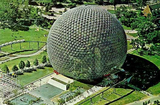 The United States pavilion was enclosed by the most memorable structure, Buckminster Fuller's 250 foot diameter geodesic dome. Unlike many of Fuller's ugly squat half domes, the one at Expo was a 3/4 sphere set amidst a park-like setting. It floated above the fairgrounds like an enormous silver bubble. During the day its acrylic skin sparkled in the sunlight, and when darkness fell, its interior lighting gave it a vari-colored glow.
