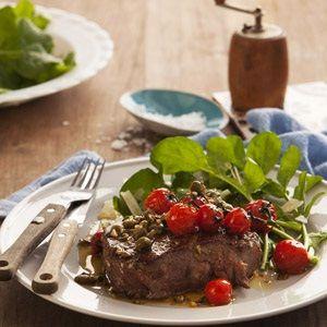 Rib eye steak with pan fried tomatoes