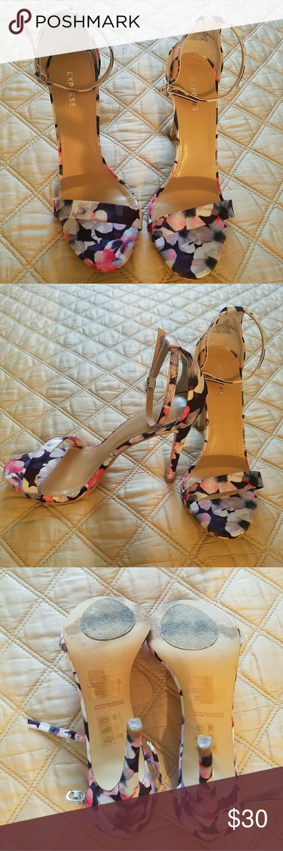 Express Floral Print Heels  (6) Used once and in good condition  Very comfortable  A heeled sandal that'll put you in the mood to strut. Design for a luxe look that lets your sexy legs assume the spotlight.  Open toe sandal Slim toe strap Counter with adjustable buckled ankle strap Synthetic upper and sole Express Shoes Heels