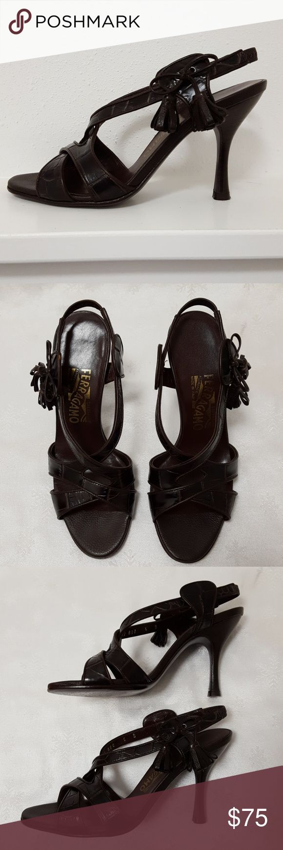 Salvatore Ferragamo Brown Strappy Heels Salvatore Ferragamo Brown Strappy Heels. Elastic at back of heel. Croco embossed leather with tassel detail on the side.  3.5 inch heel. Wear on soles and heels. Size 6 B. Salvatore Ferragamo Shoes Heels
