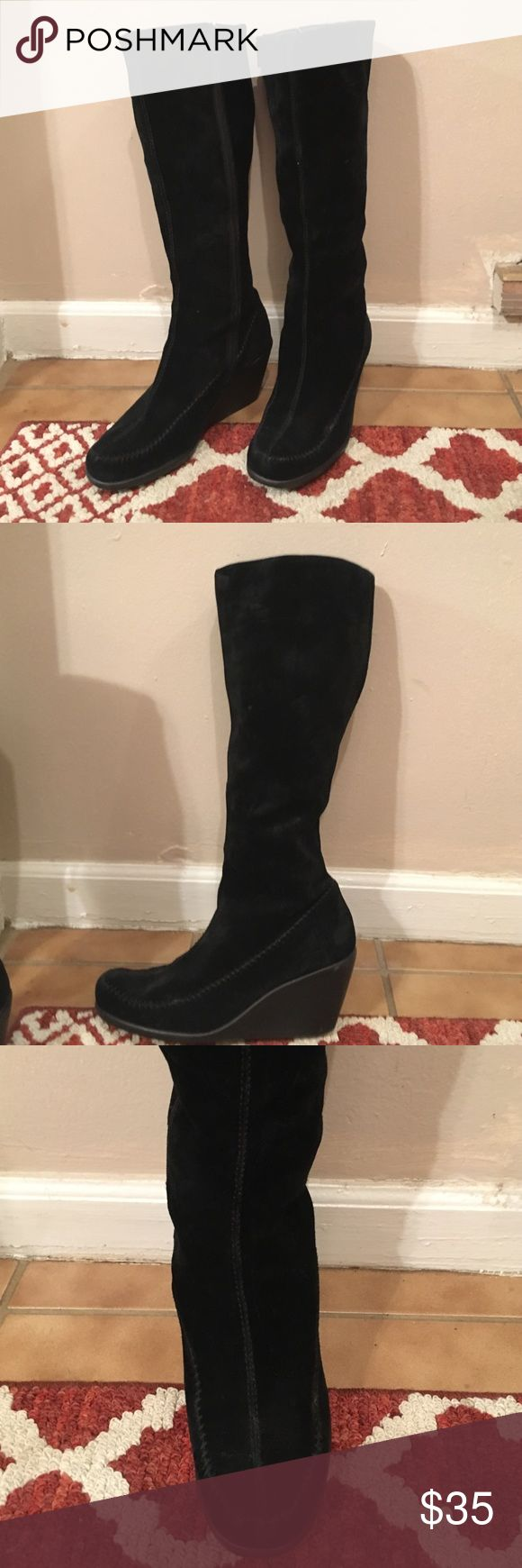 Black Suede Wedge Boots Versatile black wedge boots by Aerosoles. These boots are made from very soft suede and are the most comfortable wedge boots I ever owned. I would always receive compliments when wearing them. They are in great pre-loved condition. These boots still have many more miles in them! AEROSOLES Shoes Wedges