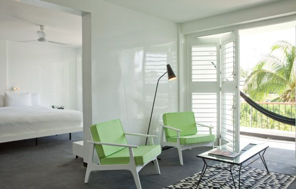 polished concrete, soft white walls/doors, patterned textures and bright textiles