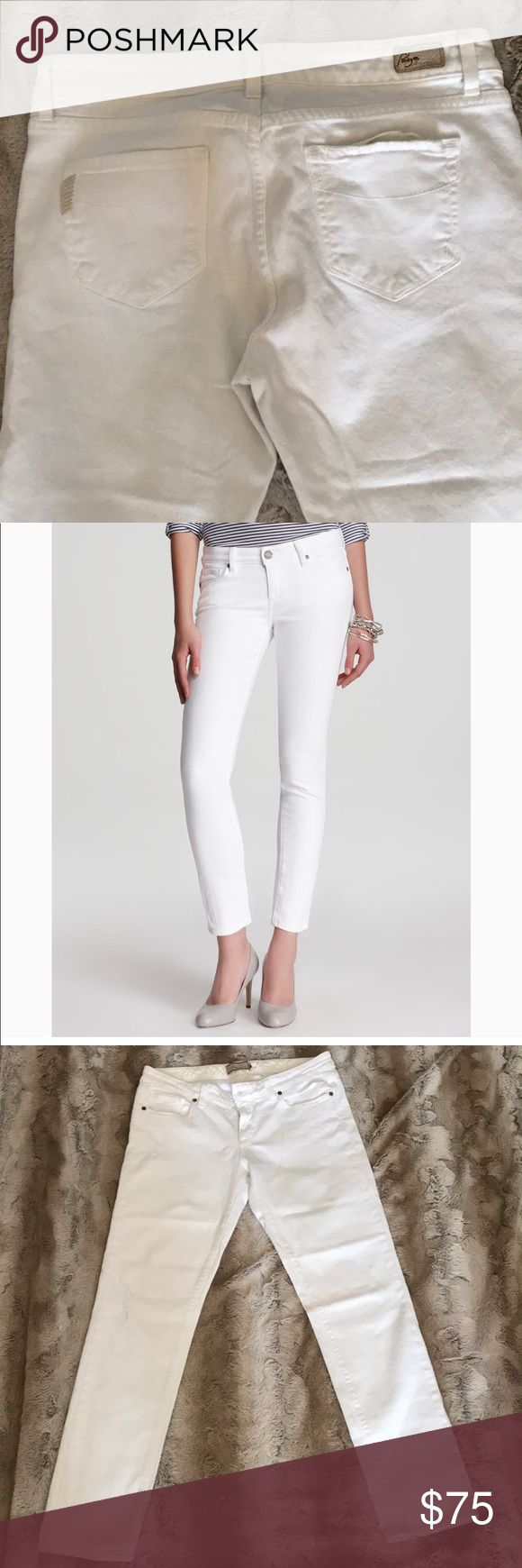 """Paige Skyline Ankle Peg Jeans in White White skinny peg jeans in white with some random intentional distressing . Zip fly closure. Belt loops and five pocket styling. 98% cotton 2% spandex. 28.5"""" inseam. 8"""" rise. 14.5"""" across waistband laying flat. I found one small spot on the right leg as shown in the photo . I haven't tried to remove it . It's hardly noticeable but please be aware . Paige Jeans Jeans Skinny"""