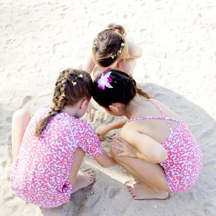 Our beach explorers in our Coral print - Rash Vest, Bikini Bottoms and Swimsuit. Available at www.frolikbeachstyle.com in sizes 2-3, 4-5, 6-7 and 8-9yrs.