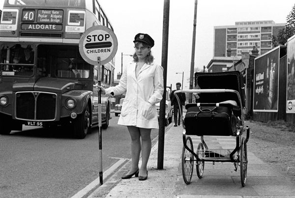 Lollipop lady at work in the East End during the 1960s with her baby in the pram.Photograph taken from London's East End A 60s Album published by The History Press  http://spitalfieldslife.com/wp-content/uploads/2011/07/East-London-97-44-low-res.jpg