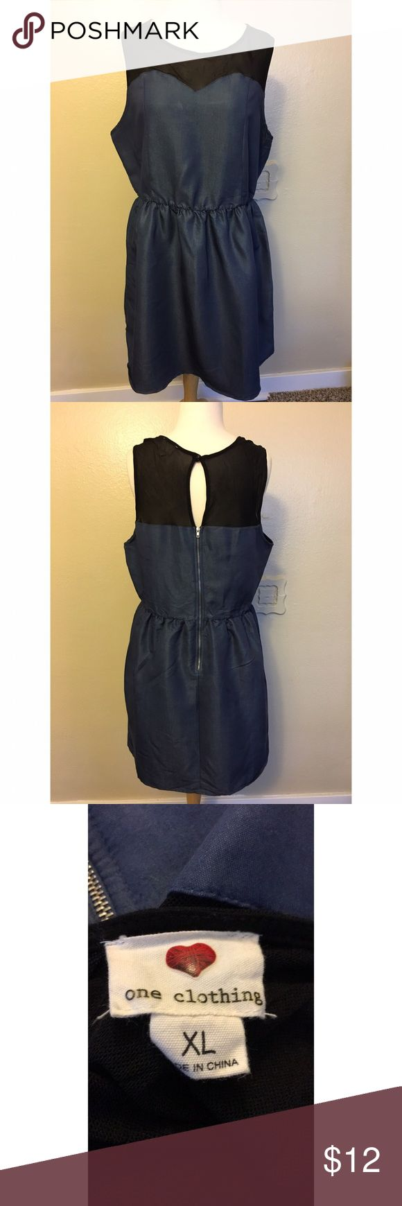 Denim Dress Denim skater dress with sweet heart line and black mesh attached to top. Zipper closure to waist along with key hole button closure. Elastic waist line. Knee length. one clothing Dresses