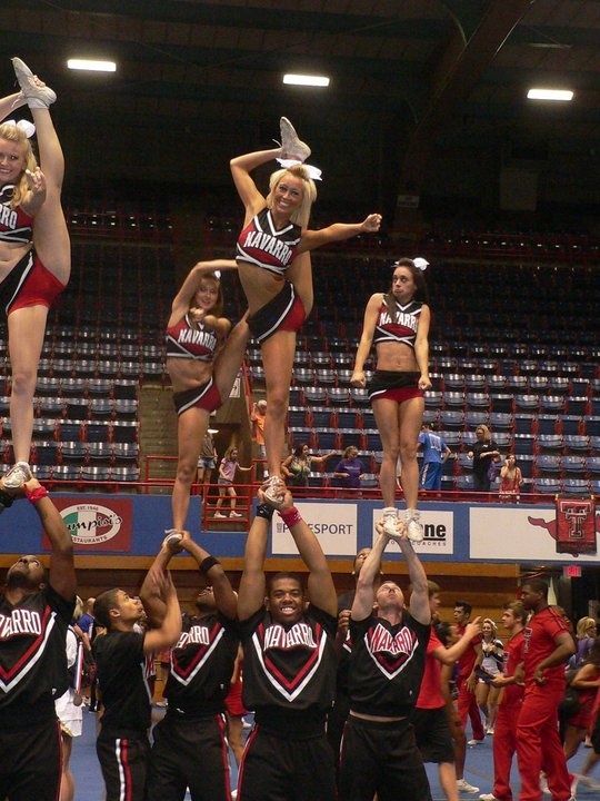 Welcome To The Cheer Nation stunt bow and arrow cheerleading cheerleader lol at the girl in the back right