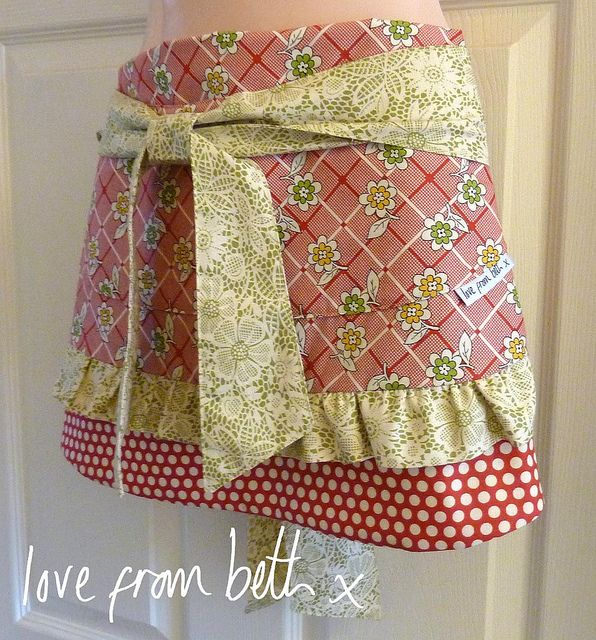 """I like this entry best in moda Bake Shop's """"Sliced"""" apron sewing contest.  It converts to a sewing table """"apron"""" to hold your scissors, etc."""