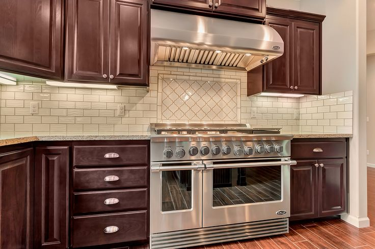Subway Tile Backsplash With A Matching Arabesque Accent