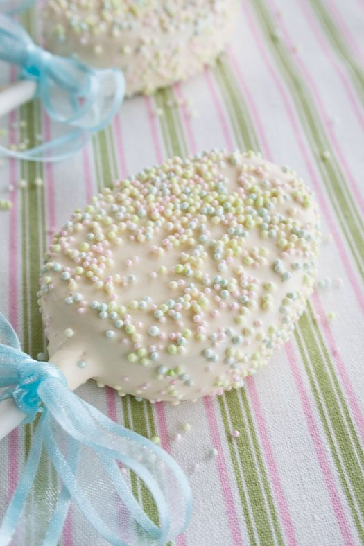 Easter egg cake pops coated with chocolate and sugar sprinkles