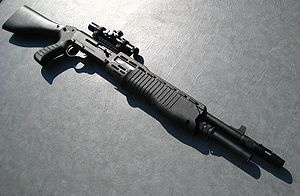 Franchi SPAS-12 [I want to shoot one of these, too, especially if it's the 8-round, metal folding stock variant, but shooting the AWP is far more realistic and likely to happen.]