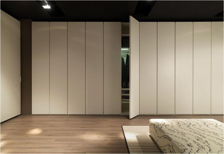 Armarios Lema, puerta Conca.  Muebles de diseño.