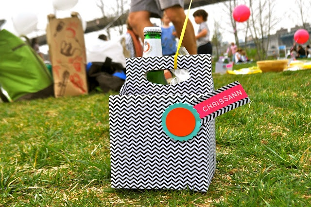 turn a cardboard 6-pack container into a picnic caddie. i think i'd rather use it as a desk organizer