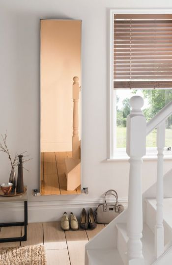 In response to an increased demand for accessories being incorporated into heating, Aestus has added the Copy Mirror Contemporary Radiator to its collection. The Copy Mirror not only offers a space-saving, free standing style, but also includes a practical mirror which is a benefit in areas such as hallways where space is at a premium. Available in a range of finishes including Bronze.
