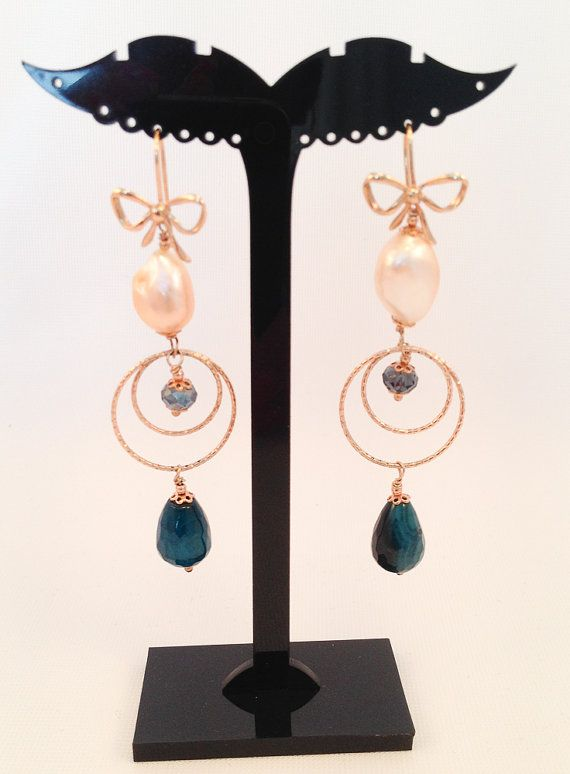 Rose water pearl, variegated blue agate and Swarovski assembled in 925 silver plated rose gold with circles and an elegant tassel.  length