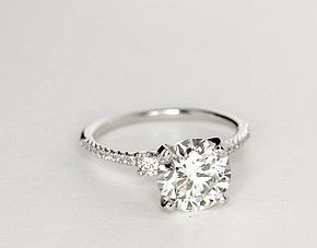 I love the two larger side stones! Petite Micropavé Trio Diamond Engagement Ring in 14k White Gold (1/4 ct. tw.)