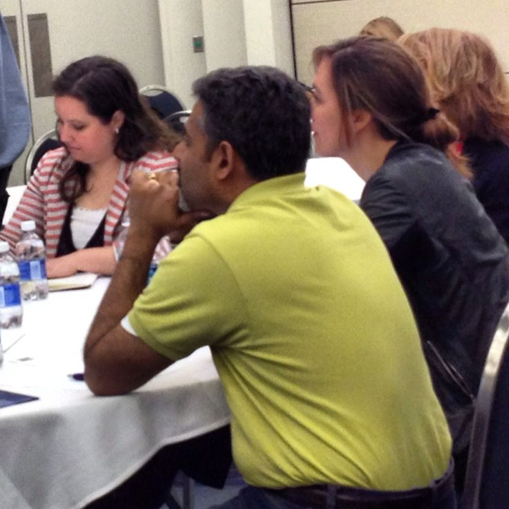 Judges listening to the presentations at the International Women's Hackathon in D.C