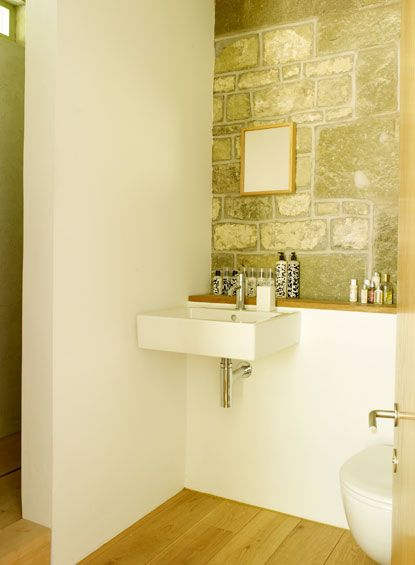 wall hung sink. small mirror, and shelf. simple, natural, and beautiful