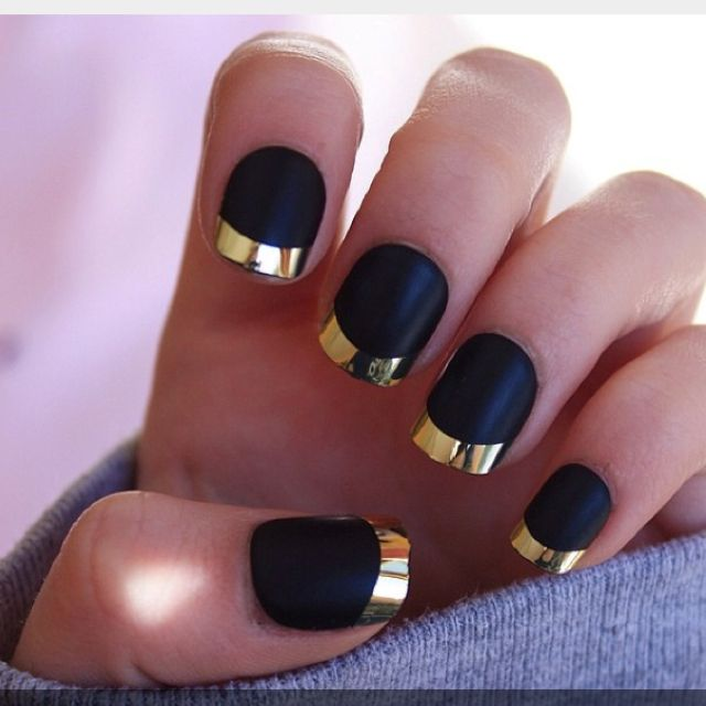 these cute black matte nails with gold tips those