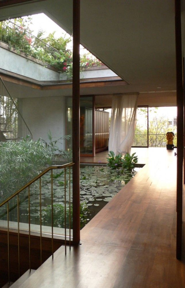 open home with hanging garden and koi pond