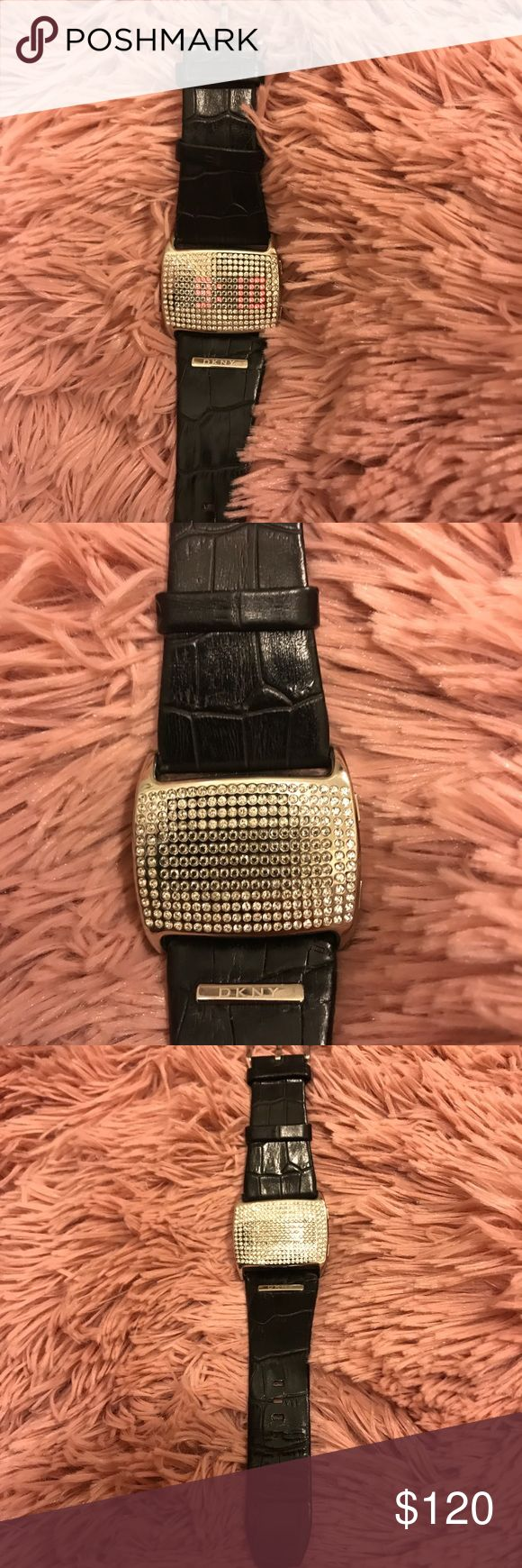 DKNY leather and crystal watch Very unique DKNY crystal watch with black leather gator embossed band. Time and date show through crystals on face when date/time button is pushed on side of watch. This is piece is gorgeous with some additional arm candy. Stack some sparkly bracelets and wear it dressed up or down. Worn only a couple times. Some scuffs or marks maybe present, but no Major damage was found when looking over watch. No missing crystals, this watch is amazing!! don't miss out and…