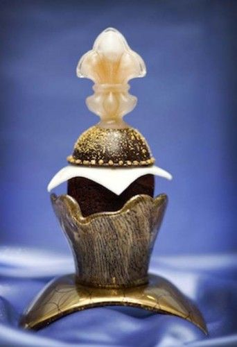 """""""The Decadence D'Or cupcake""""....Some are calling cupcakes a dying trend, but that doesn't include the rich folks who are willing to shell out $800 for one. The Decadence D'Or cupcake is made from """"Palmira Single Estate Chocolate derived from the rare and fragile Porcelana Criollo bean at the Valrhona plantation in Venezuela,"""" Eater reports, along with edible gold flakes, Tahitian Gold Vanilla Caviar, and 100-year-old Cognac. It's also encased in blown sugar."""