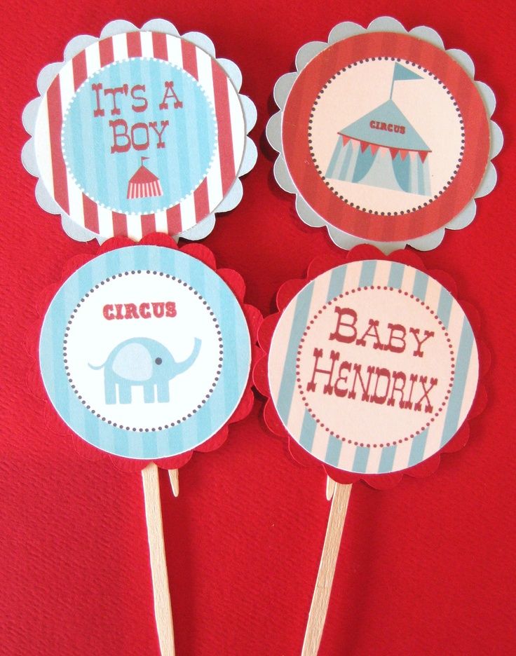 Cupcake toppers, i'm liking the elephant. I can make these with wooden craft sticks, paper and the printed elephant cartoon.