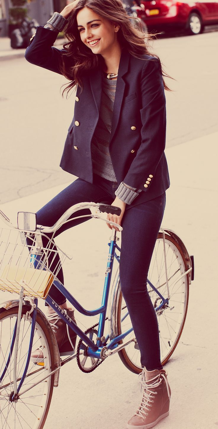 Everything about this is awesome - the vintage bike, the jacket-jumper combo, her hair, her boots...