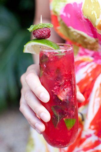 Raspberry Mojito  Ingredients:       ~3/4 shot of Bicardi Razz Rum    ~3/4 shot of Bicardi Superior Rum    ~Small splash of simple syrup    ~Small handful of fresh raspberries    ~Mint leaves    ~Lime Wedge    ~Splash of sprite    ~Soda