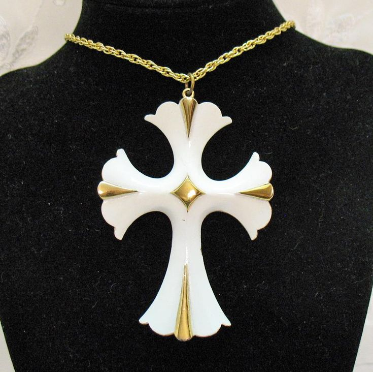 This is a big and bold heavy yellow gold plated Cross Pendant Necklace with wonderful white enameling and shiny gold trim. This vintage Cross is very