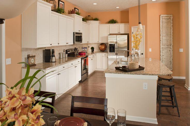 Kitchen in the twin oaks model love the white cabinets - Peach color interior design ...