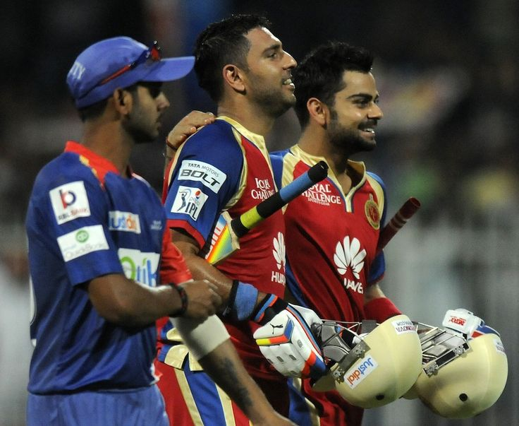 Virat Kohli and Yuvraj Singh walk off victorious