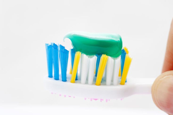 Free Stock Photo: Closeup of the bristles of a plastic toothbrush with cool…