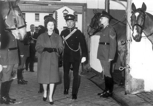 View of Queen Elizabeth II inspecting the stables of the Royal Horse Artillery at St John's Wood Barracks, November 1962. Copyright Westminster City Archives
