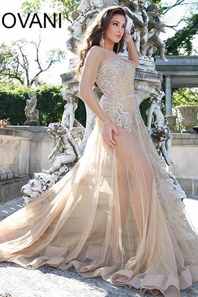 Strapless gold leotard features crystal embellishments, sheer nude long sleeves, a nude floor length skirt and a visible zipper down the back.