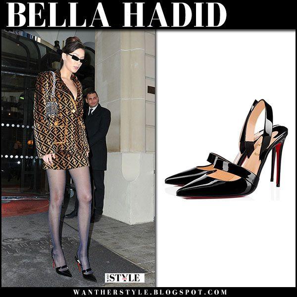 Bella Hadid in brown logo jacket and mini skirt and black slingback pumps #parisfashionweek