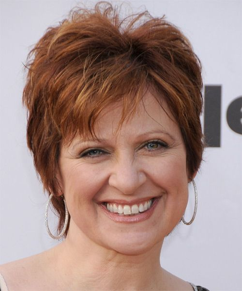 Caroline Manzo Hairstyle: Casual Short Straight. This short copper-chestnut 'do is jagged cut all over for texture and shape. This allows height and lift through the top making this hairstyle great for those looking for a low-fuss 'do to compliment a round face shape. A little product is needed for hold and shine. Face Shape: Round, Oval, Heart, and Triangular.