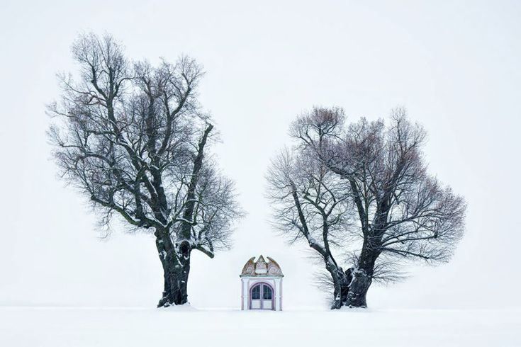 """German photographer Kilian Schönberger has captured the essence of the legendary Grimm Brothers' dark fairytales in a series of images called """"Brothers Grimm's Wanderings."""" The photos capture entrancing landscapes and buildings throughout Central Europe that are at once mystical and foreboding."""