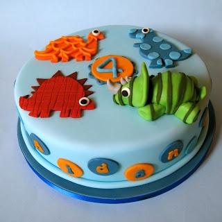 Cakes By Jacques - Beautiful Bespoke Cakes, Biscuits and Cupcakes. Meri-Meri ROARRRR! Cake. Dinosaur Birthday Cake.