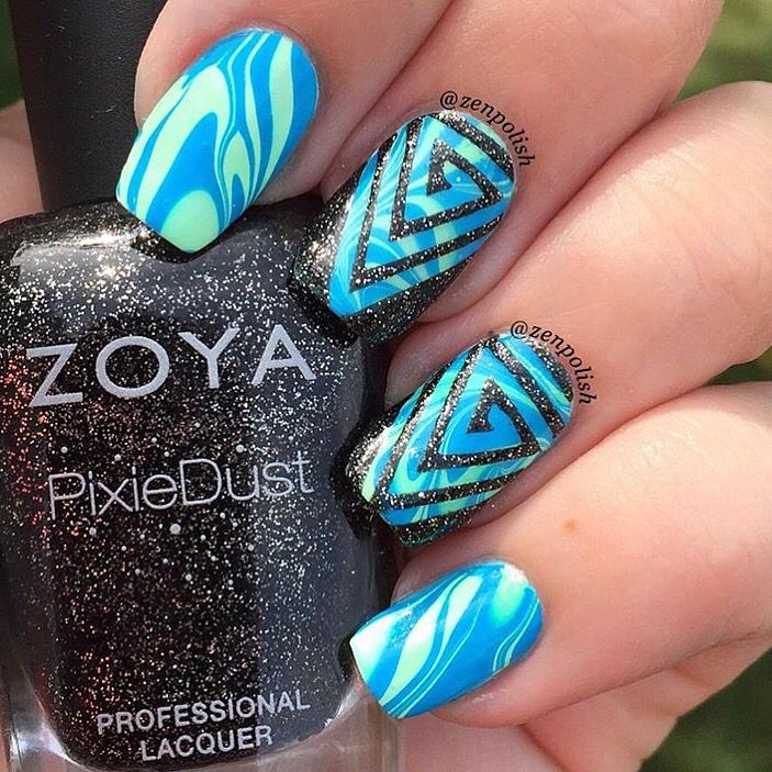 Watermarble perfection by @zenpolish topped with vinyls! She is using our Triangle Swirl Nail Vinyls found at: snailvinyls.com