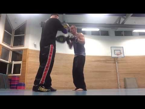 Coach Roger Mittology padwork with Kickboxer champion Arne Guddal. PADWO...