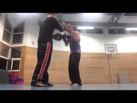 Coach Roger Mittology padwork with Kickboxer champion Arne Guddal. PADWO...