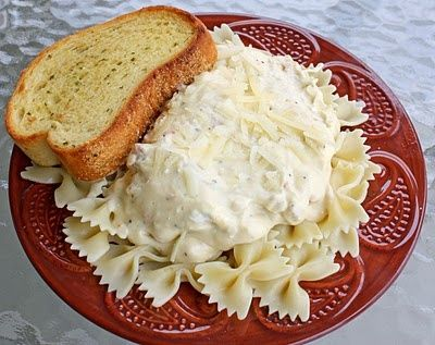 This is going in my crock pot tonight.and its smelling amazing. 4 chicken breasts, 1 block of cream cheese, 2 cans of cream of chicken soup, and a packet of zesty Italian dressing mix. 4 hours until supper! :) Were having iit over penne thoughI dont really love farfalle.