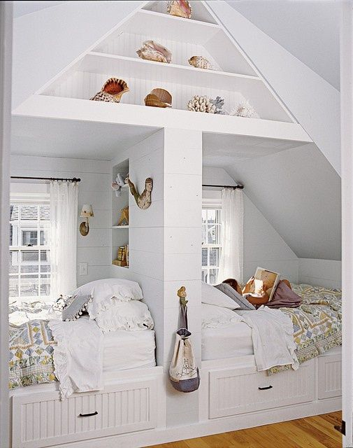 Our last home was a Cape Cod and the attic space was converted into bedrooms. The dormers and slanted roofline always made furniture arranging challenging but wow, look at this brilliant idea! The arrangement not only gives each child their own space in the alcove but it maximizes storage space too!