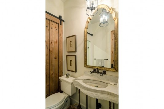 Reclaimed, white-marble sink dating to the 1800s.