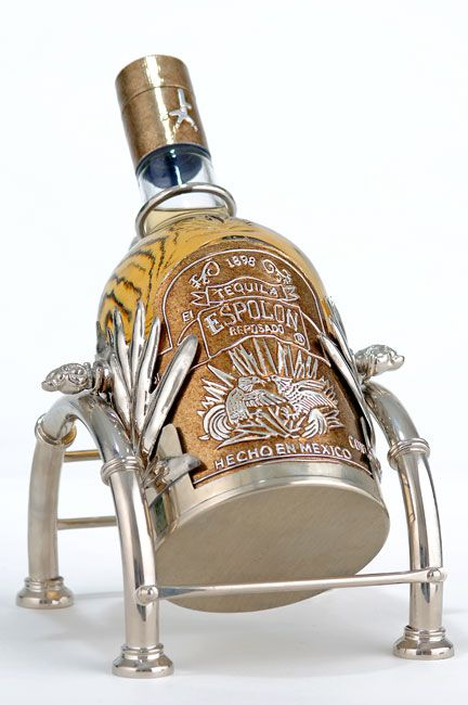 Check out this fantastic bottle glorifer. Custombeerhandles.com will design and produce a custom bottle glorifer that will get your tequila brand noticed!